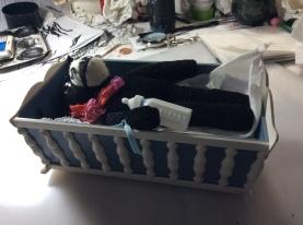 Felix in crib